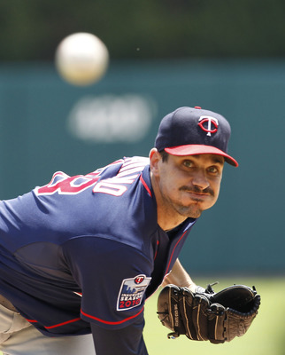 DETROIT - JULY 11:  Carl Pavano #48 of the Minnesota Twins warms up prior to the start of the game against the Detroit Tigers on July 11, 2010 at Comerica Park in Detroit, Michigan. The Twins defeated the Tigers 6-3. (Photo by Leon Halip/Getty Images)