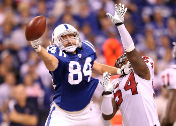 INDIANAPOLIS - NOVEMBER 01:  Jacob Tamme #84 of Indianapolis Colts reaches out to grab a pass while defended by Zac Diles #54 of the Houston Texans  during the NFL game at Lucas Oil Stadium on November 1, 2010 in Indianapolis, Indiana.  (Photo by Andy Lyo