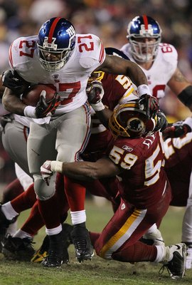 LANDOVER, MD - DECEMBER 21:  Brandon Jacobs #27 of the New York Giants runs past London Fletcher #59 of  the Washington Redskins during their game on December 21, 2009 at Fedex Field in Landover, Maryland.  (Photo by Al Bello/Getty Images)
