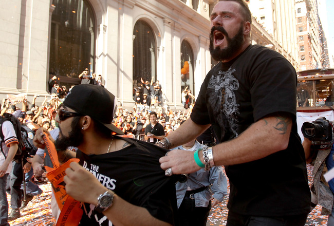 SAN FRANCISCO - NOVEMBER 03:  Pitcher Brian Wilson of the San Francisco Giants jumps on Sergio Romo during the San Francisco Giants victory parade on November 3, 2010 in San Francisco, California.  (Photo by Ezra Shaw/Getty Images)