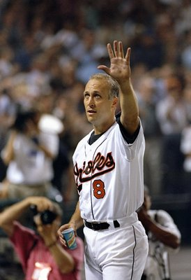 6 Sep 1995:  Shortstop Cal Ripken of the Baltimore Orioles raises hand to crowd at Camden Yards in Baltimore, Maryland  acknowledging congratulations for breaking Lou Gehrig''s record for consecutive games played.  The game was against the California Ange