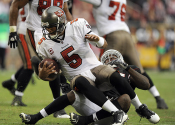 GLENDALE, AZ - OCTOBER 31:  Josh Freeman #5 of the Tampa Bay Buccaneers is sacked by Joey Porter #55 of the Arizona Cardinals at University of Phoenix Stadium on October 31, 2010 in Glendale, Arizona.  (Photo by Harry How/Getty Images)
