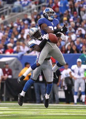 EAST RUTHERFORD, NJ - OCTOBER 17:  Mario Manningham #82 of the New York Giants has his reception broken up by C.C. Brown #39 of the Detroit Lions at New Meadowlands Stadium on October 17, 2010 in East Rutherford, New Jersey.  (Photo by Nick Laham/Getty Im