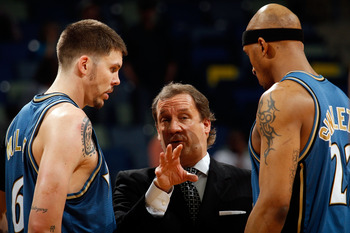 NEW ORLEANS - MARCH 31:  Mike Miller #6, head coach Flip Saunders and James Singleton #22 of the Washington Wizards talk during a timeout against the New Orleans Hornets at New Orleans Arena on March 31, 2010 in New Orleans, Louisiana.  The Wizards defeat