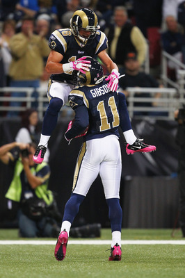 ST. LOUIS - OCTOBER 3: Brandon Gibson #11 of the St. Louis Rams is congratulated by teammate Danny Amendola #16 after scoring a touchdown against the Seattle Seahawks at the Edward Jones Dome on October 3, 2010 in St. Louis, Missouri.  The Rams beat the S