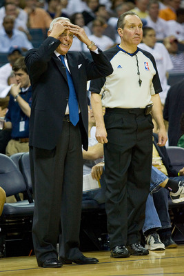 CHARLOTTE, NC - APRIL 26:  Charlotte Bobcats head coach Larry Brown reacts to a call as official Joe De Rosa looks on during second quarter action against the Orlando Magic in Game Four of the Eastern Conference Quarterfinals during the 2010 NBA Playoffs