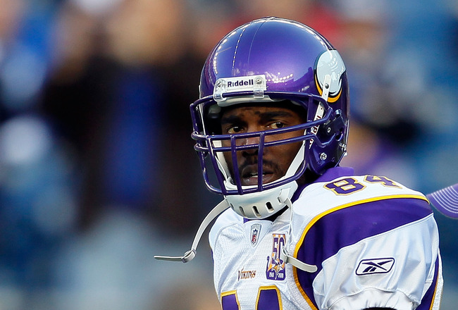 FOXBORO, MA - OCTOBER 31:  Randy Moss #84 of the Minnesota Vikings runs onto the field before a game against the New England Patriots at Gillette Stadium on October 31, 2010 in Foxboro, Massachusetts. (Photo by Jim Rogash/Getty Images)