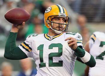 EAST RUTHERFORD, NJ - OCTOBER 31: Aaron Rodgers #12 of the Green Bay Packers throws a pass against the New York Jets on October 31, 2010 at the New Meadowlands Stadium in East Rutherford, New Jersey.The Packers defeated the Jets 9-0. (Photo by Jim McIsaac