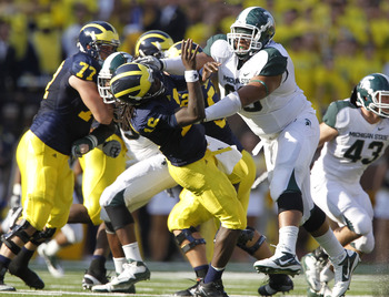 ANN ARBOR, MI - OCTOBER 09: Jerel Worthy #99 of the Michigan State Spartans hits Denard Robinson #16 of the Michigan Wolverines during the game on October 9, 2010 at Michigan Stadium in Ann Arbor, Michigan. (Photo by Leon Halip/Getty Images)