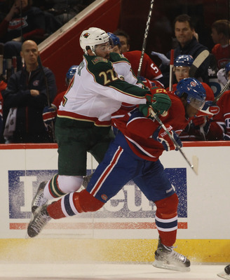 MONTREAL, QC - SEPTEMBER 26: Cal Clutterbuck #22 of the Minnesota Wild hits P.K. Subban #76 of the Montreal Canadiens at the Bell Centre on September 26, 2010 in Montreal, Canada.  (Photo by Bruce Bennett/Getty Images)