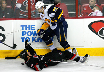RALEIGH, NC - FEBRUARY 26:  Rod Brind'Amour #17 of the Carolina Hurricanes is knocked to the ice after being hit by Patrick Kaleta #36 of the Buffalo Sabres during the game on February 26, 2009 at RBC Center in Raleigh, North Carolina.  (Photo by Kevin C.