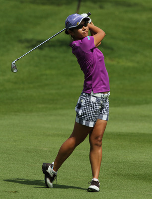 KUALA LUMPUR, MALAYSIA - OCTOBER 22 : Al Miyazato of Japan watches her 2nd shot on the 1st hole of Korea Republic during Round One of the Sime Darby LPGA on October 22, 2010 at the Kuala Lumpur Golf and Country Club in Kuala Lumpur, Malaysia. (Photo by St