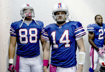 ORCHARD PARK, NY - OCTOBER 03: Jonathan Stupar #88, Ryan Fitzpatrick #14 and CJ Spiller #21  of the Buffalo Bills wait to enter the field prior to playing the New York Jets   at Ralph Wilson Stadium on October 3, 2010 in Orchard Park, New York. The Jets w