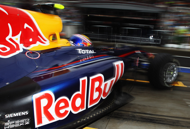 YEONGAM GUN, SOUTH KOREA - OCTOBER 24:  Mark Webber of Australia and Red Bull Racing exits his garage to drive during the Korean Formula One Grand Prix at the Korea International Circuit on October 24, 2010 in Yeongam-gun, South Korea.  (Photo by Mark Tho