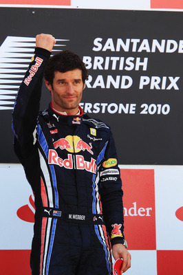 NORTHAMPTON, UNITED KINGDOM - JULY 11:  Mark Webber of Australia and Red Bull Racing celebrates on the podium after winning the British Formula One Grand Prix at Silverstone on June 11, 2010, in Northampton, England.  (Photo by Mark Thompson/Getty Images)