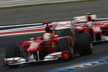 HOCKENHEIM, GERMANY - JULY 25:  Felipe Massa of Brazil and Ferrari leads from team Fernando Alonso of Spain and Ferrari during the German Grand Prix at Hockenheimring on July 25, 2010 in Hockenheim, Germany.  (Photo by Andrew Hone/Getty Images)