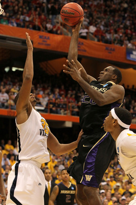 SYRACUSE, NY - MARCH 25:  Quincy Pondexter #20 of the Washington Huskies attempts a shot against Wellington Smith #35 of the West Virginia Mountaineers during the east regional semifinal of the 2010 NCAA men's basketball tournament at the Carrier Dome on