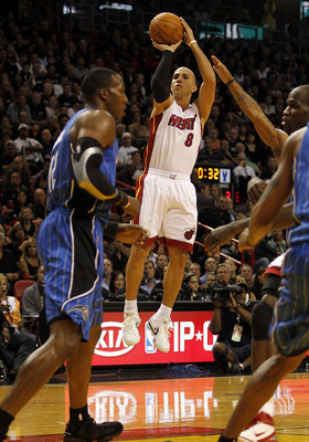MIAMI - OCTOBER 29:  Guard Carlos Arroyo #8 of the Miami Heat shoots against the Orlando Magic at American Airlines Arena on October 29, 2010 in Miami, Florida.  NOTE TO USER: User expressly acknowledges and agrees that, by downloading and or using this p