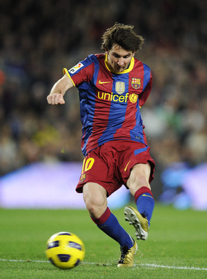 BARCELONA, SPAIN - OCTOBER 30:  Lionel Messi of Barcelona scores his second goal during the La Liga match between Barcelona and Sevilla FC on October 30, 2010 in Barcelona, Spain. Barcelona won the match 5-0.  (Photo by David Ramos/Getty Images)