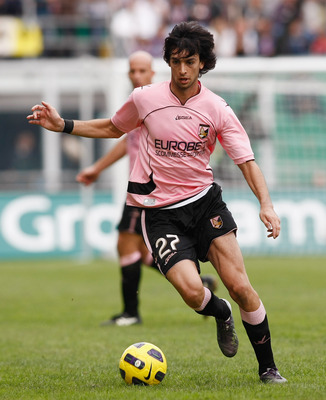 PALERMO, ITALY - OCTOBER 31:  Javier Pastore of Palermo runs with the ball during the Serie A match Palermo and Lazio at Stadio Renzo Barbera on October 31, 2010 in Palermo, Italy.  (Photo by Maurizio Lagana/Getty Images)