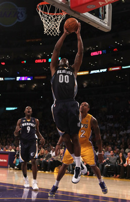 LOS ANGELES, CA - NOVEMBER 02:  Darrell Arthur#00 of the Memphis Grizzlies drives to the basket past Shannon Brown #12 of the Los Angeles Lakers during the fourth quarter at Staples Center on November 2, 2010 in Los Angeles, California. The Lakers defeate