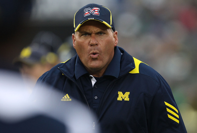 SOUTH BEND, IN - SEPTEMBER 11: Head coach Rich Rodriguez of the Michigan Wolverines yells at an assistant coach during a game against the Notre Dame Fighting Irish at Notre Dame Stadium on September 11, 2010 in South Bend, Indiana. Michigan defeated Notre
