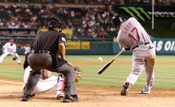 ANAHEIM, CA - JULY 27:  Shin-Soo Choo #17 of the Cleveland Indians hits a single against the Los Angeles Angels of Anaheim in the ninth inning at Angel Stadium on July 27, 2009 in Anaheim, California. The Indians defeated the Angels 8-6.  (Photo by Jeff G