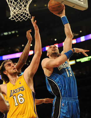 LOS ANGELES, CA - JANUARY 18:  Marcin Gortat #13 of the Orlando Magic goes to the basket against Pau Gasol #16 of the Los Angeles Lakers in the third quarter during the game on January 18, 2010 at Staples Center in Los Angeles, California. NOTE TO USER: U