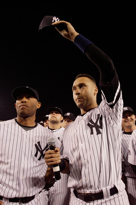 NEW YORK - SEPTEMBER 21:  Derek Jeter #2 and Mariano Rivera #42 of the New York Yankees wave to fans after the last regular season game at Yankee Stadium on September 21, 2008 in the Bronx borough of New York City. The Yankees are playing their final seas