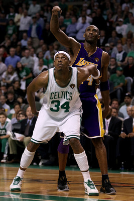 BOSTON - JUNE 10:  Paul Pierce #34 of the Boston Celltics and Kobe Bryant #24 of the Los Angeles Lakers wait under the basket during Game Four of the 2010 NBA Finals on June 10, 2010 at TD Garden in Boston, Massachusetts. NOTE TO USER: User expressly ackn