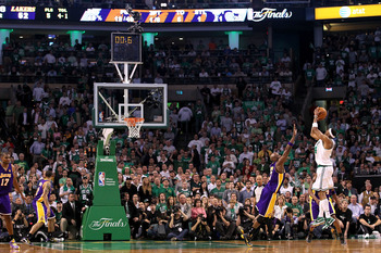 BOSTON - JUNE 08:  Paul Pierce #34 of the Boston Celtics puts a shot up over Lamar Odom #7 of the Los Angeles Lakers at the end of the first half of Game Three of the 2010 NBA Finals on June 8, 2010 at TD Garden in Boston, Massachusetts. NOTE TO USER: Use