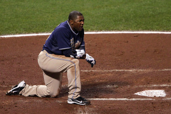SAN FRANCISCO - OCTOBER 01:  Miguel Tejada #10 of the San Diego Padres reacts after being tagged out at home plate during the first inning against the San Francisco Giants at AT&T Park on October 1, 2010 in San Francisco, California.  (Photo by Justin Sul