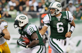 EAST RUTHERFORD, NJ - OCTOBER 31: Mark Sanchez #6 of the New York Jets hands the ball to teammate LaDainian Tomlinson #21 against the Green Bay Packers on October 31, 2010 at the New Meadowlands Stadium in East Rutherford, New Jersey. The Packers defeated