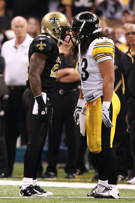 NEW ORLEANS - OCTOBER 31:  Julius Jones #21 of the New Orleans Saints and Troy Polamalu #43 of the Pittsburgh Steelers exchange words during their game at Louisiana Superdome on October 31, 2010 in New Orleans, Louisiana.  The Saints won 20-10 over the St