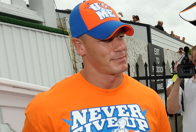 LONG POND, PA - JUNE 06:  WWE champion and co-grand marshal John Cena (L) and Joey Logano, driver of the #20 Home Depot Toyota, talk in Victory Lane prior to the NASCAR Sprint Cup Series Gillette Fusion ProGlide 500 at Pocono Raceway on June 6, 2010 in Lo