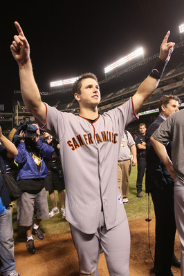 ARLINGTON, TX - NOVEMBER 01:  Buster Posey #28 of the San Francisco Giants celebrates on the field after the Giants won 3-1 the Texas Rangers in Game Five of the 2010 MLB World Series at Rangers Ballpark in Arlington on November 1, 2010 in Arlington, Texa