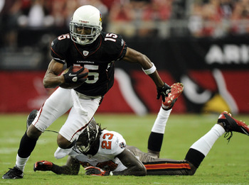 GLENDALE, AZ - OCTOBER 31:  Steve Breaston #15 of the Arizona Cardinals loses a shoe as he eludes the tackle from Myron Lewis #23 of the Tampa Bay Buccaneers during the fourth quarter at University of Phoenix Stadium on October 31, 2010 in Glendale, Arizo