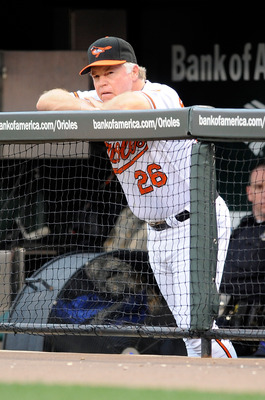 BALTIMORE - AUGUST 03:  Manager Buck Showalter of the Baltimore Orioles watches the game against the Los Angeles Angels of Anaheim at Camden Yards on August 3, 2010 in Baltimore, Maryland.  (Photo by Greg Fiume/Getty Images)