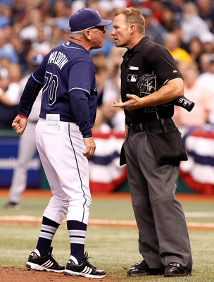 ST. PETERSBURG - OCTOBER 07:  Manager Joe Maddon #70 of the Tampa Bay Rays argues with homeplate umpire Jim Wolf after being ejected against the Texas Rangers during Game 2 of the ALDS at Tropicana Field on October 7, 2010 in St. Petersburg, Florida.  (Ph