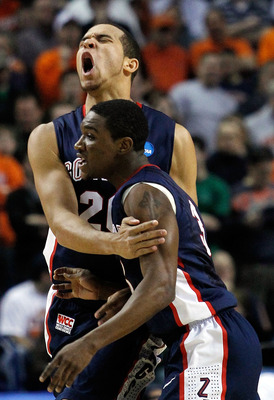 BUFFALO, NY - MARCH 21:  Elias Harris #20  of the Gonzaga Bulldogs reacts after a basket with teammate Demetri Goodson #3 of the Syracuse Orange during the second round of the 2010 NCAA men's basketball tournament at HSBC Arena at HSBC Arena on March 21,