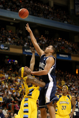 BOISE, ID - MARCH 20:  Forward Tai Wesley #42 of the Utah State Aggies shoots ball against the Marquette Golden Eagles in the first round of the NCAA Division I Men's Basketball Tournament at the Taco Bell Arena on March 20, 2009 in Boise, Idaho.  (Photo