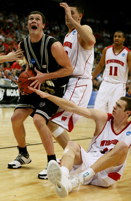 JACKSONVILLE, FL - MARCH 19:  Noah Dahlman #42 of the Wofford Terriers grabs a rebound between Keaton Nankivil #52 and Jon Leuer #30 of the Wisconsin Badgers during the first round of the 2010 NCAA men's basketball tournament at Jacksonville Veteran's Mem