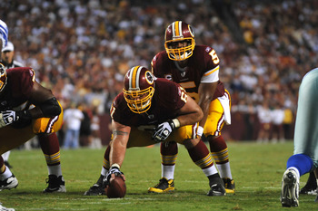 LANDOVER - SEPTEMBER 12:  Casey Rabach #61 of the Washington Redskins prepares to snap the ball during the NFL season opener against the Dallas Cowboys at FedExField on September 12, 2010 in Landover, Maryland. The Redskins defeated the Cowboys 13-7. (Pho