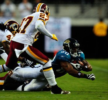 JACKSONVILLE, FL - SEPTEMBER 03:  Mike Thomas #80 of the Jacksonville Jaguars rushes for yardage during the game against the Washington Redskins at Jacksonville Municipal Stadium on September 3, 2009 in Jacksonville, Florida.  (Photo by Sam Greenwood/Gett