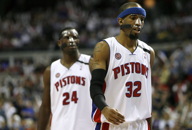 AUBURN HILLS, MI - MAY 05:  Richard Hamilton #32 and Antonio McDyess #24 of the Detroit Pistons who both wear protective masks walk up the court while playing the Orlando Magic during Game Two of the Eastern Conference Semifinals during the 2008 NBA Playo