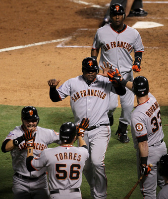 ARLINGTON, TX - NOVEMBER 01:   Cody Ross #13, Edgar Renteria #16, Juan Uribe #5, Andres Torres #56 and Aaron Rowand #33 of the San Francisco Giants celebrate after they scored on a 3-run home run hit by Renteria #16 in the seventh inning against the Texas