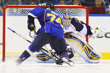 ST. LOUIS - OCTOBER 30: T.J. Oshie #74 of the St. Louis Blues takes a shot against Ondrej Pavelec #31 of the Atlanta Thrashers during an overtime shootout at the Scottrade Center on October 30, 2010 in St. Louis, Missouri.  The Blues beat the Thrashers 4-