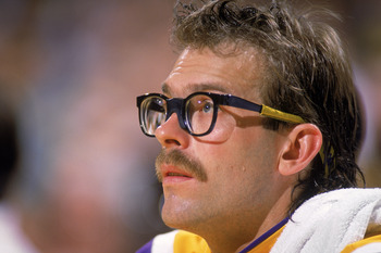 LOS ANGELES - 1987:  Kurt Rambis #31 of the Los Angeles Lakers sits on the bench during an NBA game at the Great Western Forum in Los Angeles, California in 1987. (Photo by: Mike Powell/Getty Images)