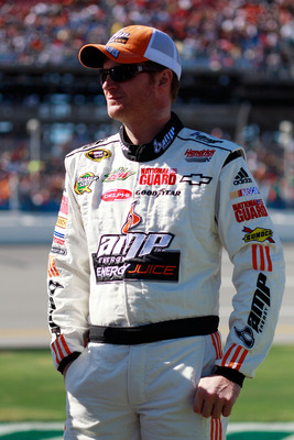 TALLADEGA, AL - OCTOBER 31:  Dale Earnhardt Jr., driver of the #88 Amp Energy Juice/National Guard Chevrolet, stands on pit road before the NASCAR Sprint Cup Series AMP Energy Juice 500 at Talladega Superspeedway on October 31, 2010 in Talladega, Alabama.