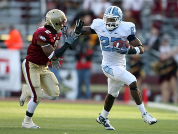 CHESTNUT HILL, MA - NOVEMBER 21:  Deunta Williams #27 of the North Carolina Tar Heels carries the ball as Montel Harris #2 of the Boston College Eagles tries to make the stop on November 21, 2009 at Alumni Stadium in Chestnut Hill, Massachusetts. The Tar